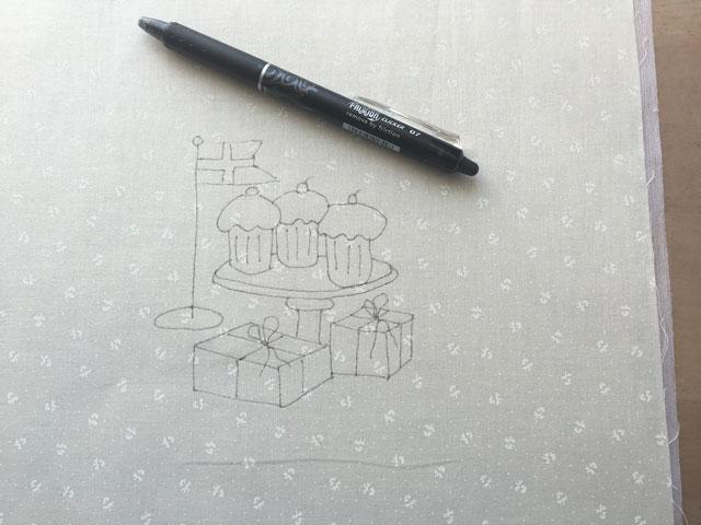 Hvordan tegner jeg mit stitchery mønster over på stoffet ??